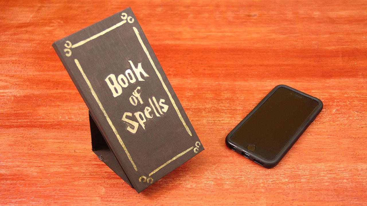 porta celular libro de hechizos